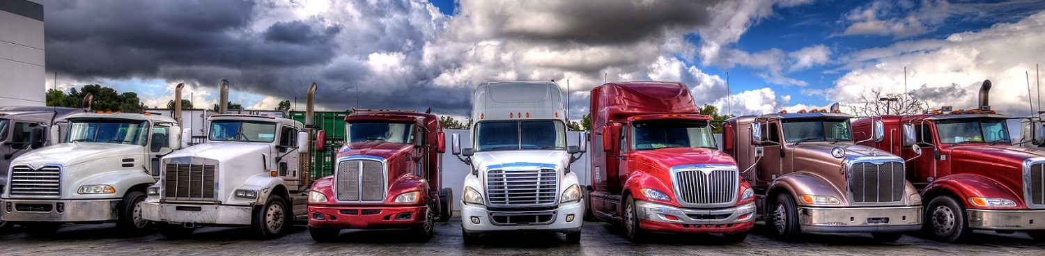 Gemini Transportation Semi trucks lined up on a parking lot